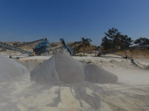 DJI Closeup on Heaps of Sand at Processing Plant